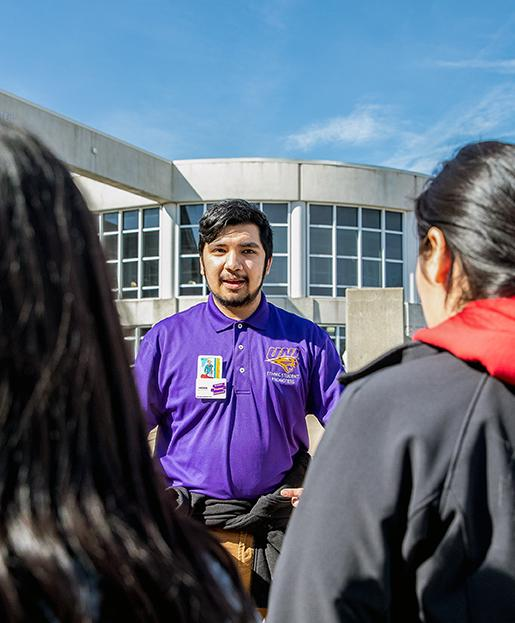 Student tour guide speaking to students at Latinx Student Day
